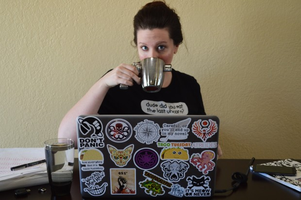 Kitty Lusby sips her coffee at her sticker covered laptop as she blogs and teaches about blogging